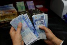 تحسن سعر صرف الدرهم أمام الدولار بـ 0,45 في المائة 7